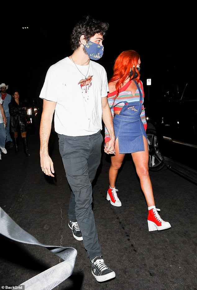 Super close: Stassie Karanikolaou was seen holding hands with new beau Noah Centineo later on Friday night, while leaving a private Halloween house party in Los Angeles