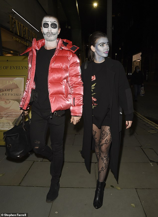 Leggy: Faye flaunted her toned pins as she donned patterned tights and a long black jacket