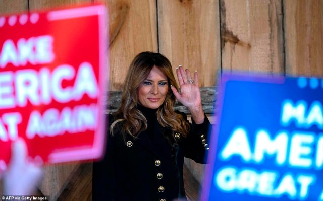 The glamorous First Lady - who bundled up against the Midwest autumnal chill in a long, dark coat - also ripped into congressional Democrats, accusing them of 'selfishly' holding up financial aid for needy Americans