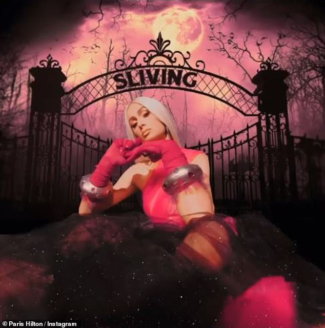 'Sliving' her best life: Paris posted a festive photo to Instagram late last night, that featured her photoshopped in front of the gates of a spooky graveyard as she got in the spirit of Halloween