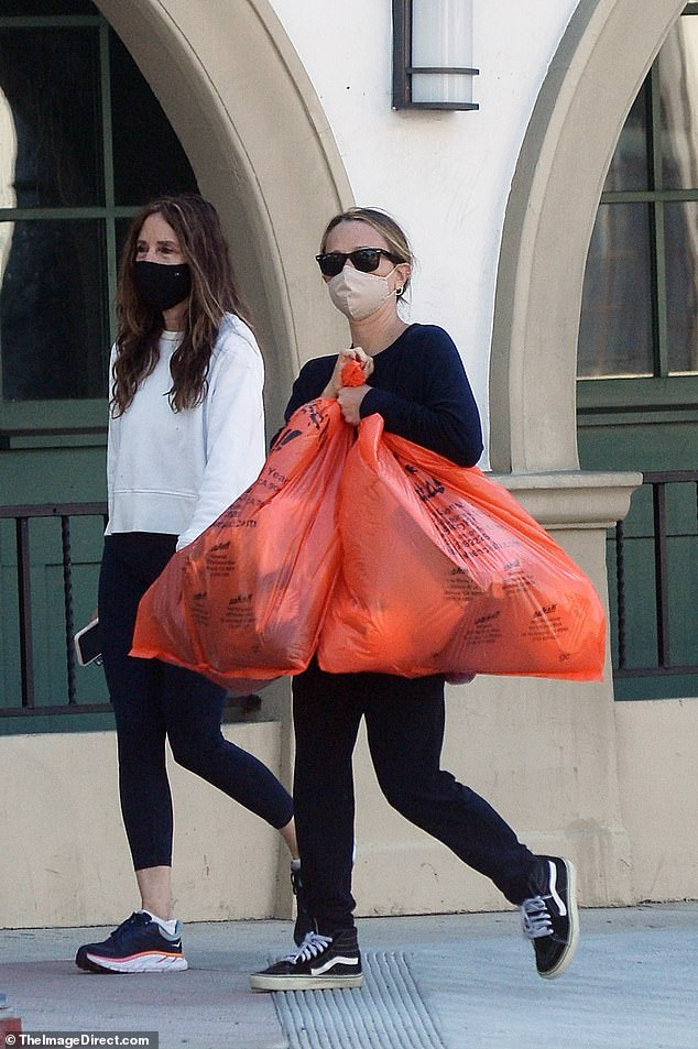 Errands: Jennifer Meyer is pictured out in Los Angeles on Saturday after filing for divorce from Tobey Maguire after a four-year separation