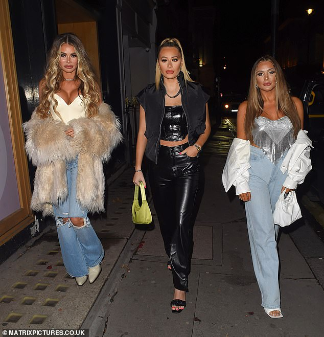 Glam squad:The TOWIE star, 37, was sure to turn heads as she squeezed her very ample assets into a busty latex corset top as she and her siblings strutted down the street
