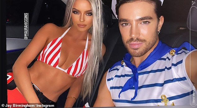 Hot stuff: Maura's look showcased her washboard abs and incredible sun-kissed complexion, as she cooly gazed into the camera in the back of a taxi with her pal Jay Birmingham