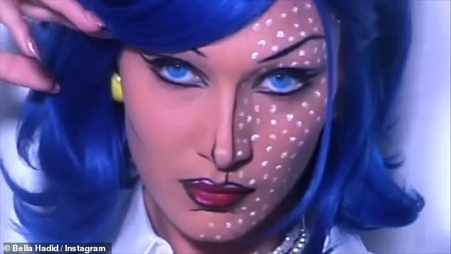 Pop art dream: Bella Hadid, 24, transforms into a Roy Lichtenstein painting for Halloween. The supermodel stunned in a blue wig and expertly pixelated makeup as she brought the legendary artist's creations to life