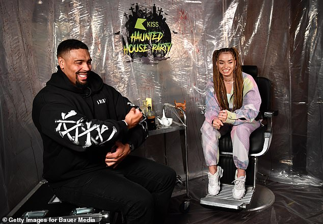 Lovely: Earlier in the evening, Ella sported a colourful ensemble as she was interviewed by Kiss FM host Jordan Banjo ahead of her performance