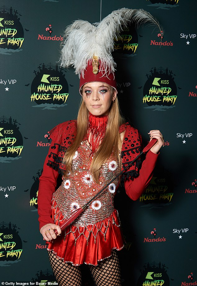 Stand to attention: Becky Hill also put in an appearance at the house party and went all out in her Halloween costume