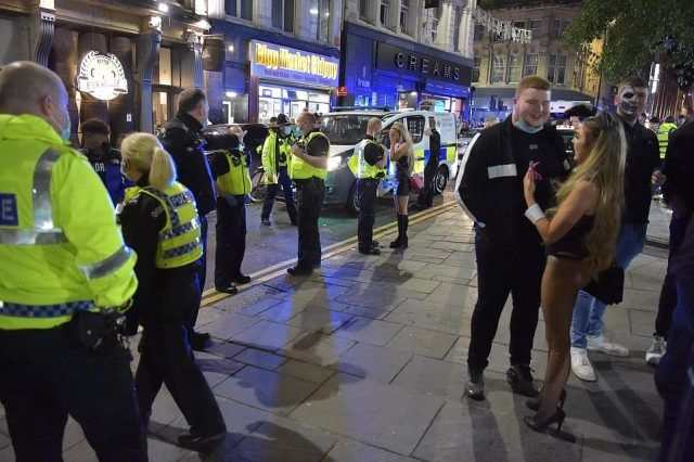 Police are seen enforcing the 10pm curfew in Newcastle city centre tonight ahead of England's new shutdown