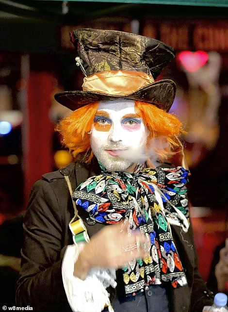 A man dressed as the Mad Hatter from Alice in Wonderland