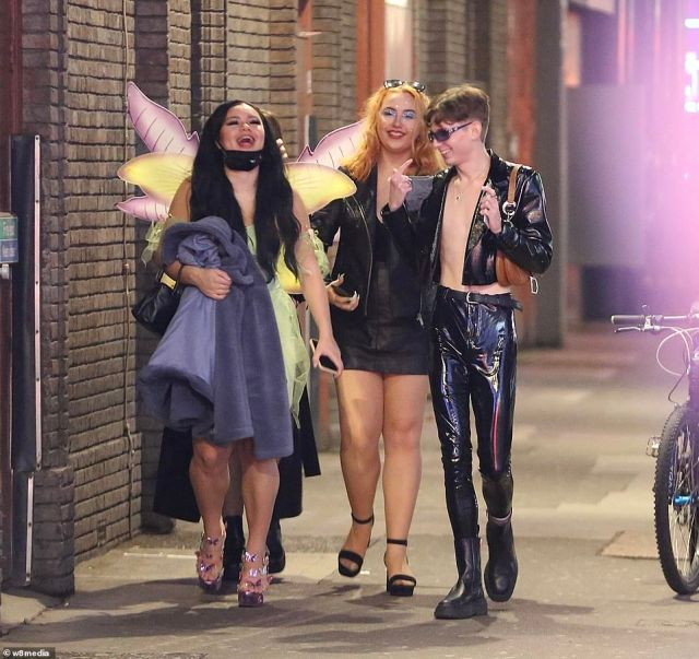 A group of young people went out in Soho in fancy dress on the last Saturday before England's shutdown begins