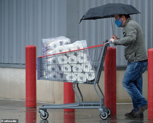 Shoppers braved atrocious weather yesterday to stock up on household essentials ahead of the lockdown