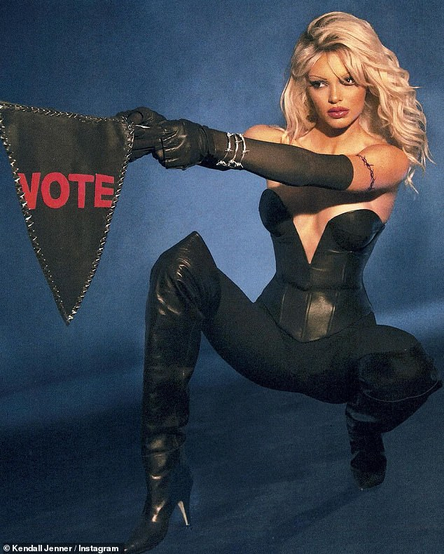 Making a statement: Jenner wielded a triangular 'Vote' flag and had on a leather bustier and tall black leather boots