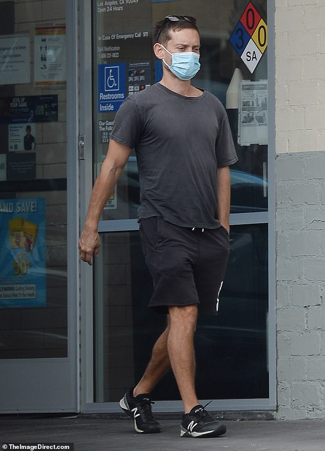 No fuss: The Spider Man actor, 45, looked extremely low-key during his Halloween outing, rocking a grey shirt and shorts while visiting a local convenience store