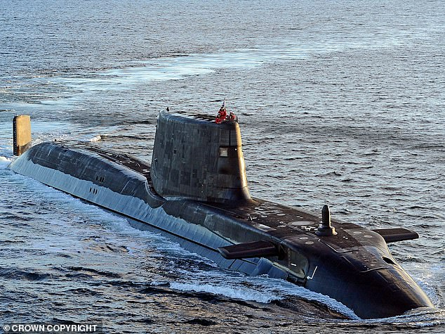 Members of the team are understood to have been deployed to Faslane to track down underwater drones or surveillance equipment placed around the Clyde estuary (pictured, submarine near Faslane)