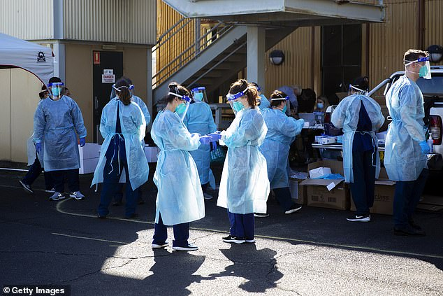 Healthcare workers at a pop-up COVID-19 testing clinic in Rushcutters Bay. The new infection comes after NSW reported no new cases of the deadly virus in the 24 hours to 8pm on Saturday night
