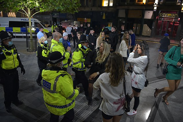 Apter said the fact that the new lockdown was reported in the media before it was officially announced by the government risked creating 'blurred lines and confusion' around new rules. Pictured: Police with Halloween revellers in Newcastle on Saturday