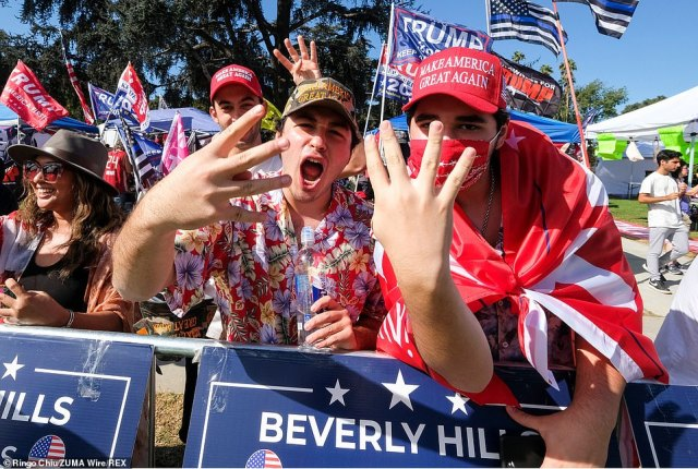 Thousands of President Donald Trump's supporters gathered on Saturday afternoon in Beverly Hills for a 'USA Freedom Rally'. Above, the Trump backers hold up four fingers as they call for 'four more years' for the Republican president