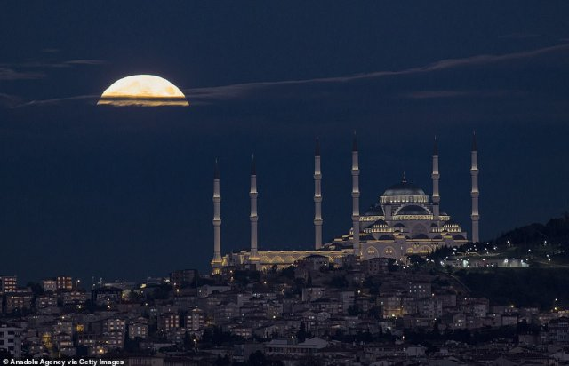 In Istanbul, Turkey, the moon was seen hanging over the Great Camlica Mosque