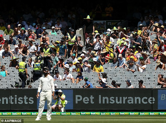 Cricket Australia on Thursday confirmed 25,000 fans could attend the Boxing Day Test at the MCG. Pictured: fans cheer at the 2018 Boxing Day Test at the MCG