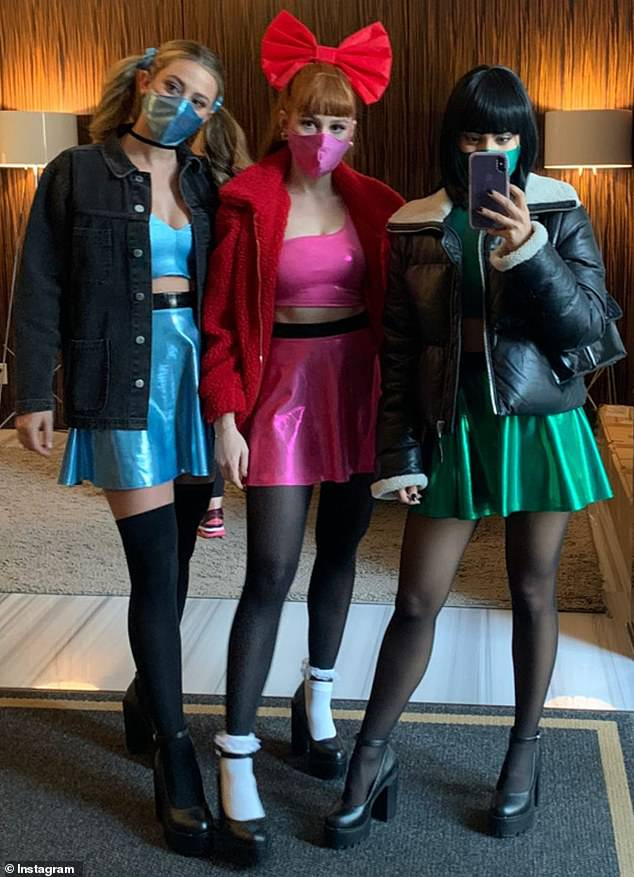 Wear a mask: They took a group mirror selfie before leaving, as they each complemented their costumes with matching face masks