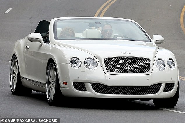 Riding in style: Following their meal, the A-list couple stepped into their white Bentley and drove off