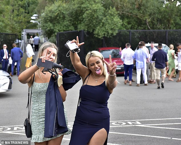Australia recorded zero new coronavirus cases across the nation for the first time in five months on Sunday. Pictured: patrons pose after leaving Rose Hill Gardens race course on Saturday