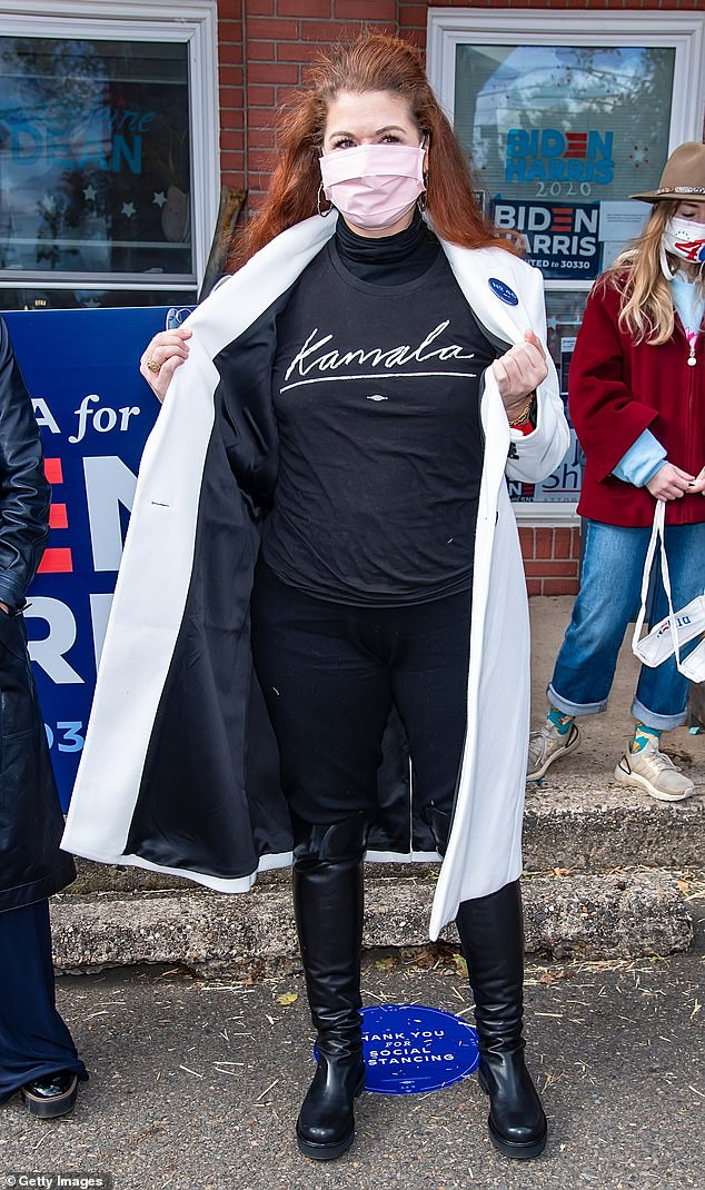Stylish support: Messing showed her support in a black shirt with 'Kamala' written on the front, along with black pants, black knee-high boots and a white overcoat