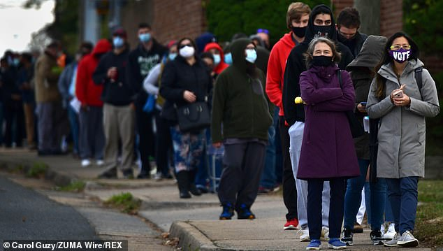 Voters stand in line in Alexandria, Virginia, on Saturday to cast their ballot