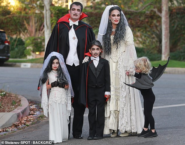 Dracula family: Molly Sims served undead glam Saturday in a Bride of Dracula costume, as her family kept with the vampire theme, going all out for trick-or-treating in their Santa Monica neighborhood