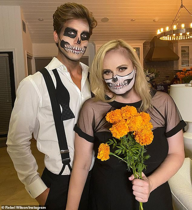 'HAUNTe COUTURe': Rebel Wilson and Jacob Busch took to Instagram on Sunday to flaunt first-ever Halloween together