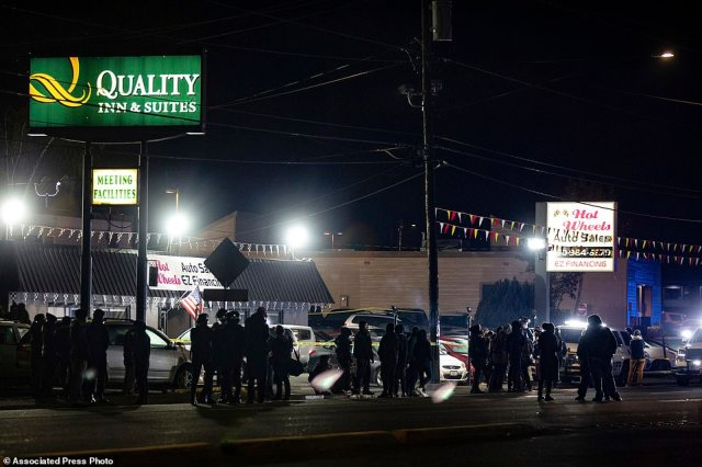 Protesters faced off with law enforcement officers after a police shooting earlier in the week