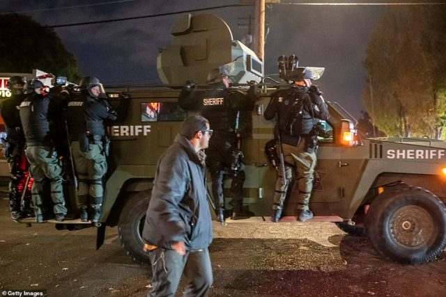 Clark County Sheriffs deputies disperse a crowd of protesters. There were city-wide dueling protests between Black Lives Matter activists and supporters of President Donald Trump