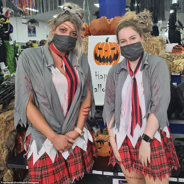 Two women pose as schoolgirls with blood-smeared uniforms and face masks to create COVID-19 inspired outfits