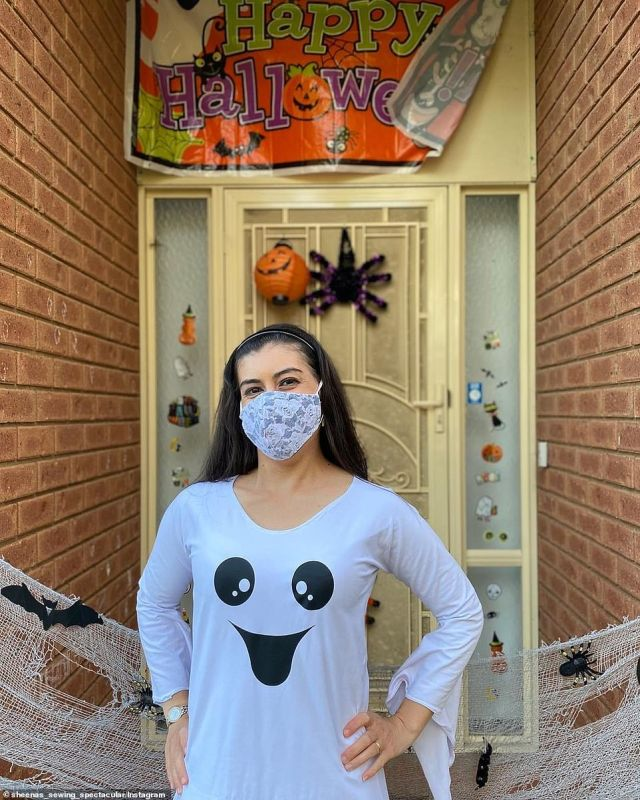 A Victorian mother strung fake cob webs and spiders across the family's home and dressed as a ghost with a white dress and rose-patterned face mask