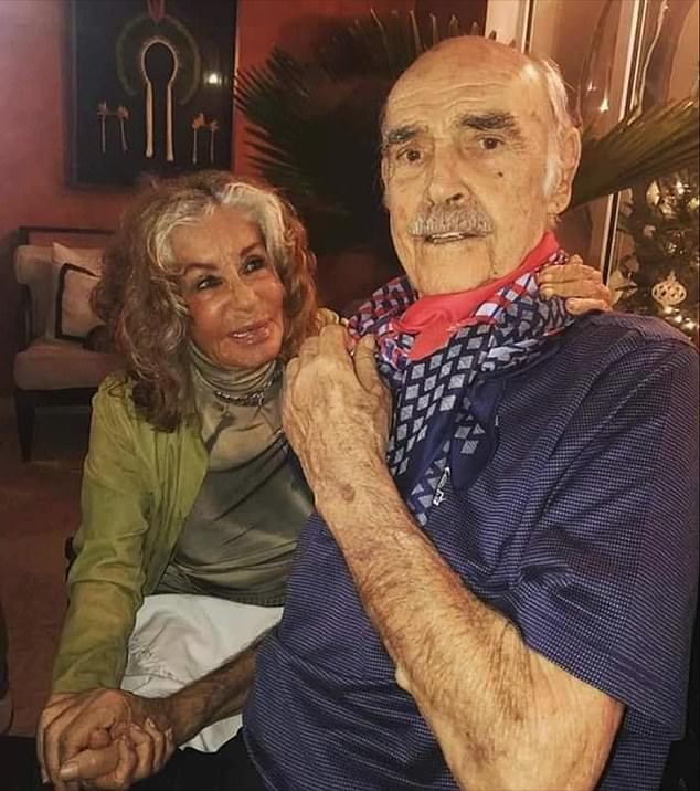 Devoted: Sir Sean Connery clasps his doting wife's hand in one of the last pictures of the couple – taken months before he died after suffering dementia