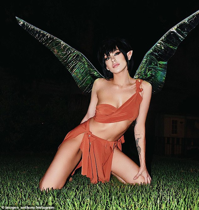 Nailed it! Kyle Sandilands' ex-girlfriend Imogen Anthony, 29, went as a fairy from FernGully, donning a burnt orange crop top and skirt, a blunt black wig and wings