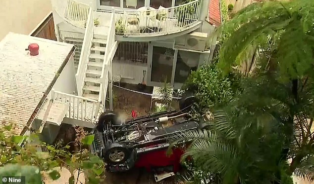 The Jeep remains in Marie's backyard and will be winched out by a crane
