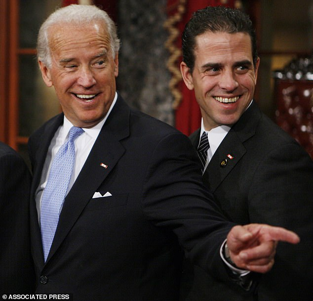 Presidential hopeful Joe Biden (left) stands with his son Hunter during a re-enactment of the Senate oath ceremony, Tuesday, Jan. 6, 2009, in the Old Senate Chamber, Washington