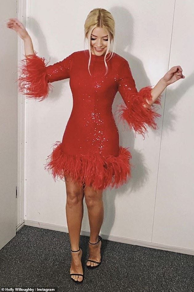 Feeling festive!Feathers appear to be a new favourite for Holly as she wowed in a sequin frock which boasted a feathered hem and cuffs as she teased she was 'filming something festive'