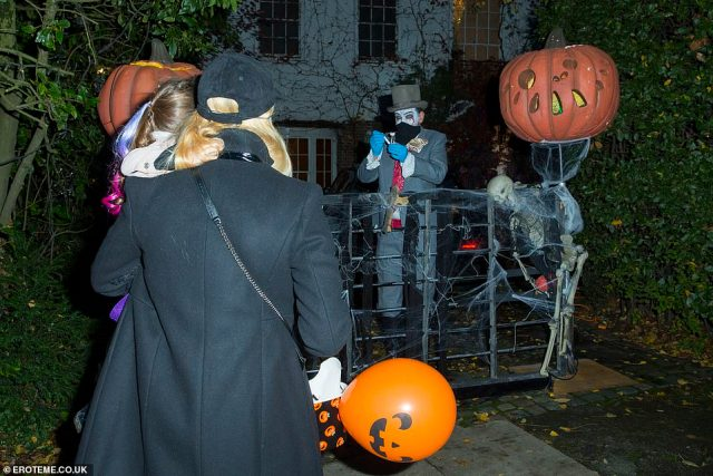 Entertainment: The chat show host still ensured there was some entertainment for trick-or-treaters as he had two ghoulish figures handing out treats