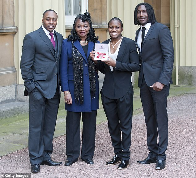 Childhood: The former professional boxer, 38, has previously described her mother (centre left) as her hero and recalled trying to protect her from her abusive father as a child