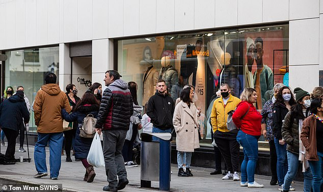 Shoppers head to Bristol city centre to do some last minute shopping as all non-essential shops are due to close