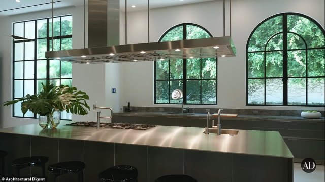 The home features four kitchens including this 'Show Kitchen' with windows looking towards the backyard