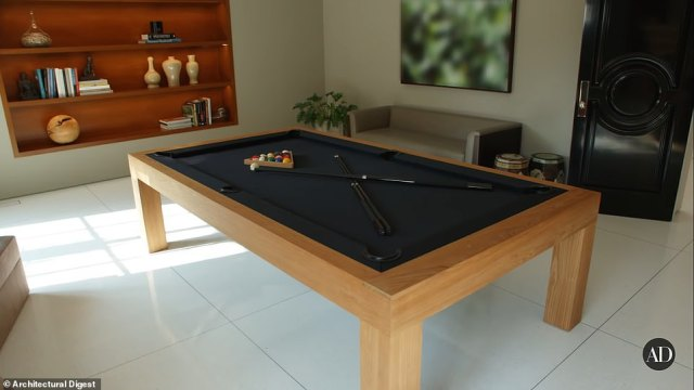 One of the many entertainment rooms includes the elegant billiards room as pictured above