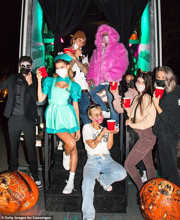 Amazing pumpkins:The Biebers partied responsibly in face masks for the at-home event, at one point surrounded by pals who enjoyed tequila cocktails and admired their costumes