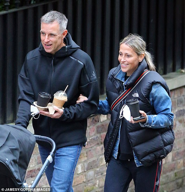 All smiles:The All Saints Singer, 45, flashed a beaming smile as she walked arm-in-arm with her other half, while he pushed their daughter's pram along the pavement.