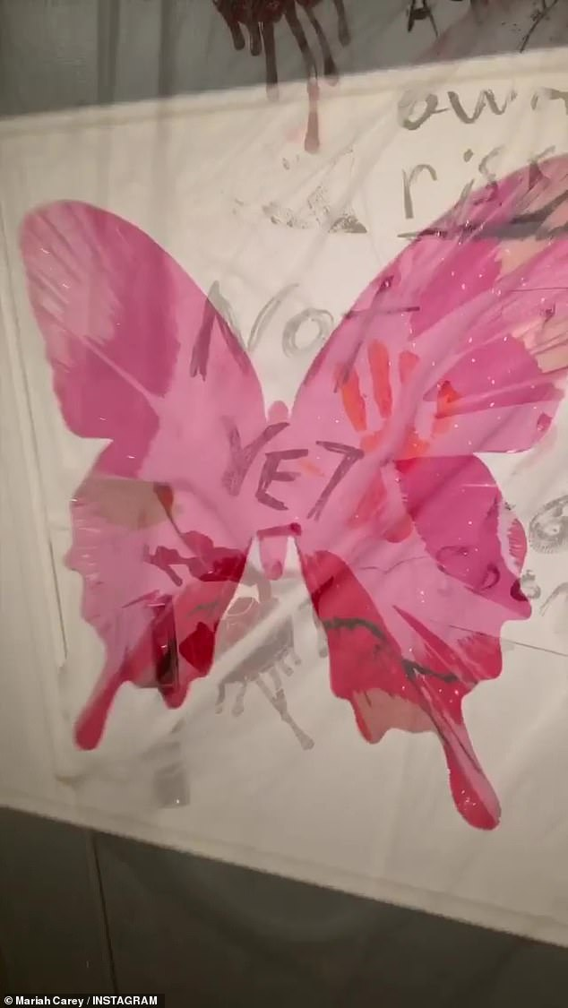 Yikes! Before entering one room, a bright pink butterfly was covered in bloody hand prints and the words 'not yet' scrawled across the wings