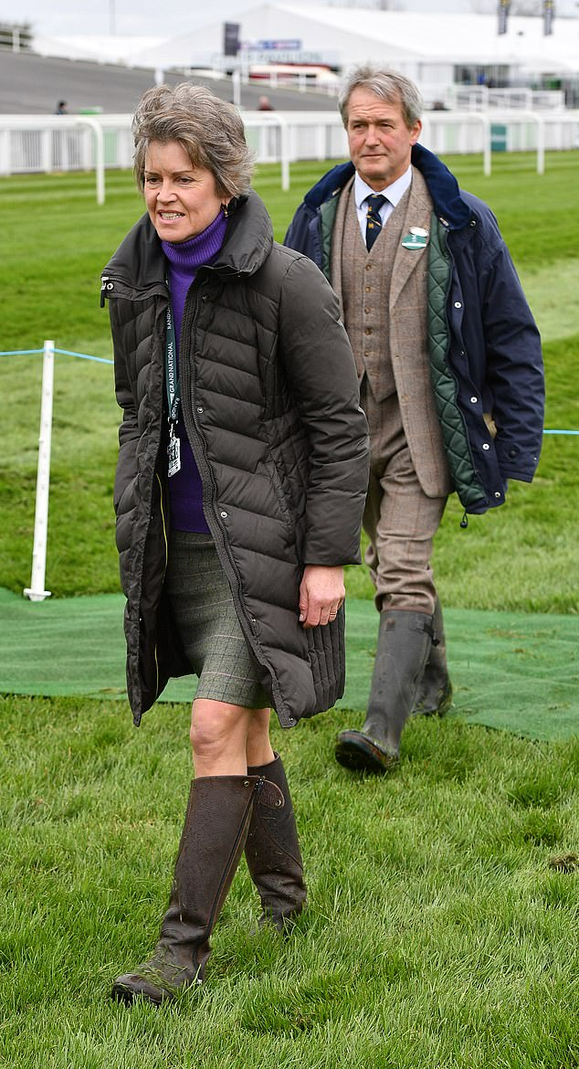 Opening day of the Grand National Festival at Aintree Racecourse, Liverpool, Merseyside. Owen Paterson with wife Rose Ridley walk the course