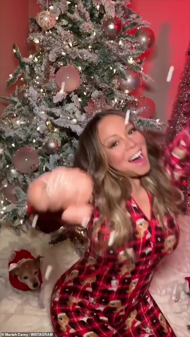 Blessings: She giggled with joy as she threw her arms up in the air while sitting in front of a decked out Christmas tree