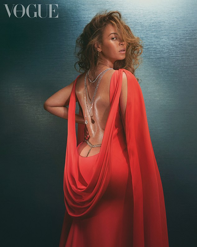 Incredible: Beyonce sizzled in a backless red gown as she discussed motherhood and being a businesswoman for British Vogue as part of their new special December 2020 issue