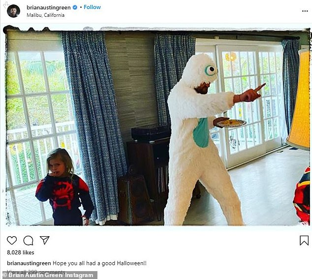 Fun daddy: The 34-year-old commented on a photo of Green, 47, dancing in a yeti costume as their youngest Journey, four, walked past Spider-Man